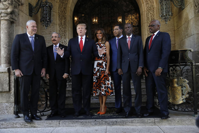 President Donald Trump and first lady Melania Trump meet with Caribbean leaders at Mar-A Lago, Friday, March 22, 2019, in Palm Beach, Fla. From left are Saint Lucia's Prime Minister Allen Michael Chastanet, Dominican Republic President Danilo Medina, President Trump, Melania Trump, Jamaica's Prime Minister Andrew Holness, Haiti President Jovenel Moise and Bahama Prime Minister Hubert Minnis. (AP Photo/Carolyn Kaster)