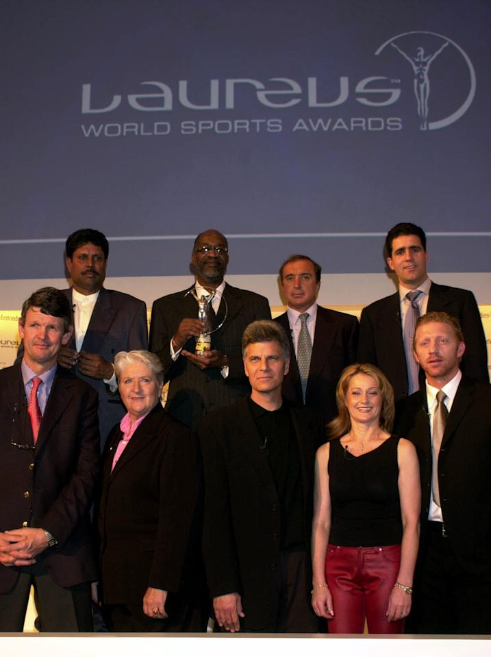 13 Mar 2001:  The World Sports Academy (back row, L to R) Kapil Dev, Edwin Moses, Hugo Porta, Migual Indurain (front row, L to R) Morne du Plessis, Dawn Fraser, Mark Spitz, Nadia Comaneci and Boris Becker at the annoucement of the Laureus World Sports Award Nominations at the Hotel Adlon, Berlin, Germany. Digital Image. Mandatory Credit: Allsport UK/ALLSPORT