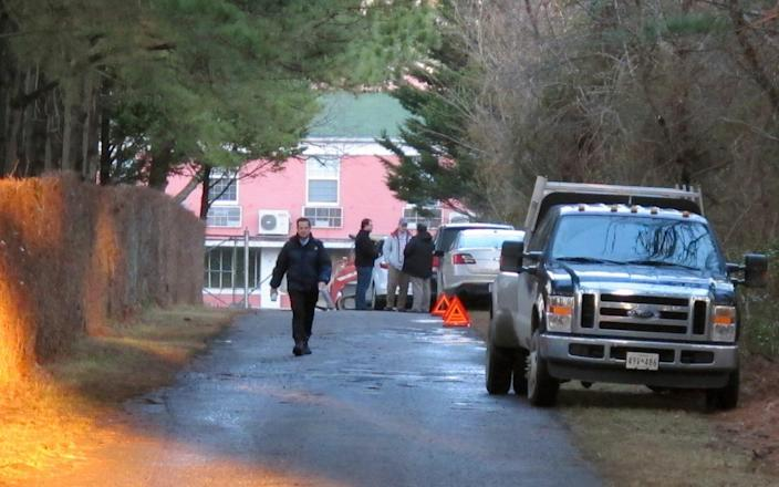State department personnel outside the Maryland compound in December  - Credit: Brian Witte/AP