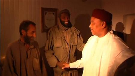 Video still shows Niger's President Issoufou greeting released French hostages in Niamey