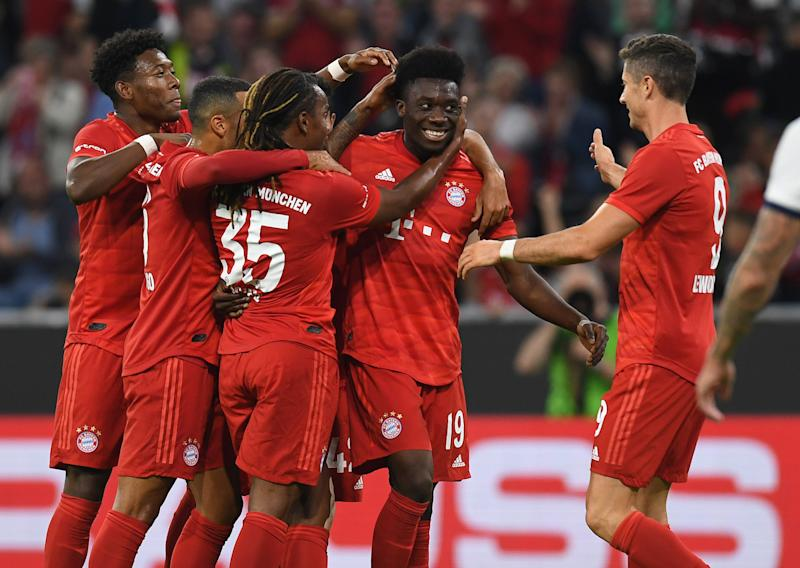 Canadian midfielder Alphonso Davies celebrates scoring with his teammates during the Audi Cup final between FC Bayern Munich and Tottenham Hotspur. (Photo by Christof Stache/AFP/Getty Images)