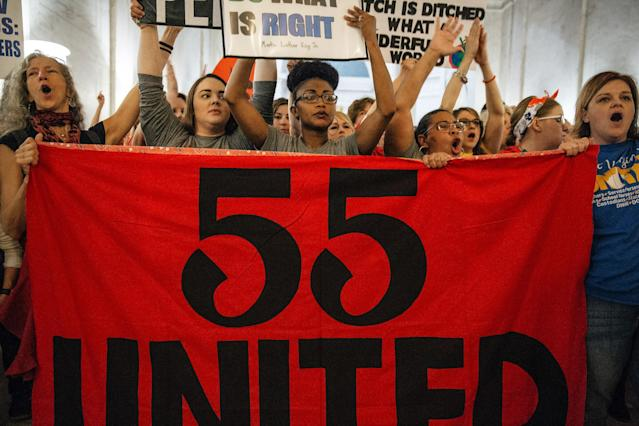 "<p>Striking school workers hold a ""55 United"" sign while chanting inside the West Virginia Capitol in Charleston, W.Va., on Friday, March 2, 2018. (Photo: Scott Heins/Bloomberg via Getty Images) </p>"