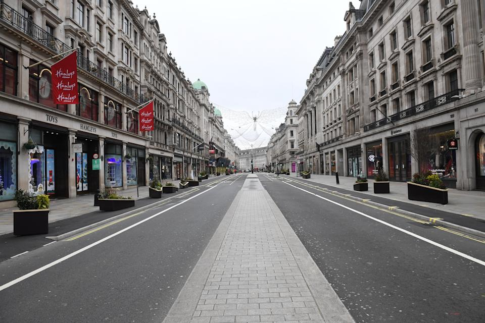Regent Street in London stands empty during what would normally be the Boxing Day sales. Boxing Day spending is expected to fall by more than a quarter compared with a year ago, after extensive new Covid-19 restrictions forced non-essential retailers to close. (Photo by Stefan Rousseau/PA Images via Getty Images)