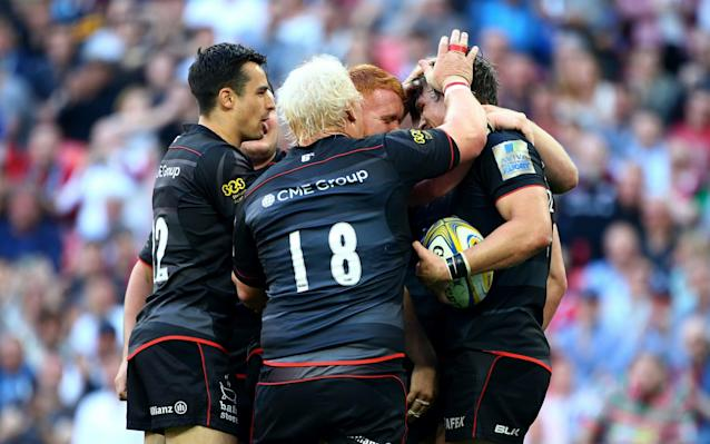 <span>Michael Rhodes celebrates after scoring Saracens' third try against Harlequins</span> <span>Credit: Getty Images </span>