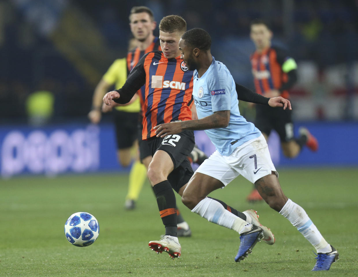 Manchester City Raheem Sterling, right, and Shakhtar Mykola Matviyenko challenge for the ball during the Group F Champions League soccer match between FC Shakhtar Donetsk and Manchester City at the Metalist Stadium in Kharkiv, Ukraine, Tuesday, Oct. 23, 2018. (AP Photo/Efrem Lukatsky)