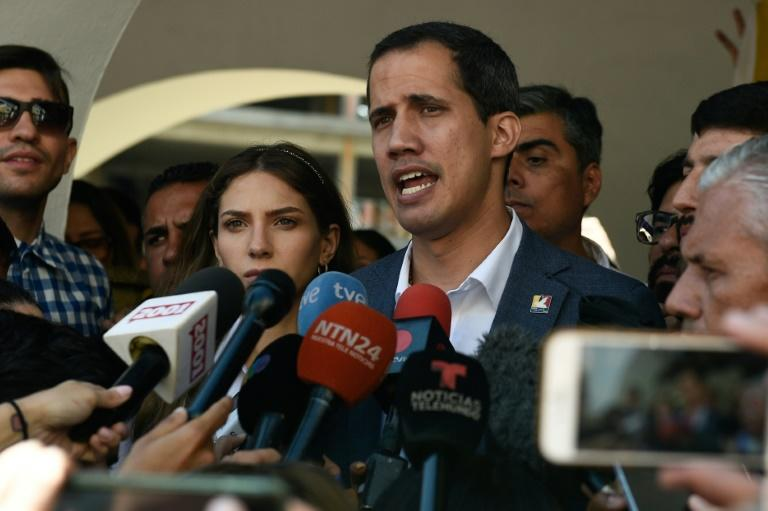 Juan Guaido, Venezuela's National Assembly leader and self-proclaimed acting president, is in a test of wills with President Nicolas Maduro