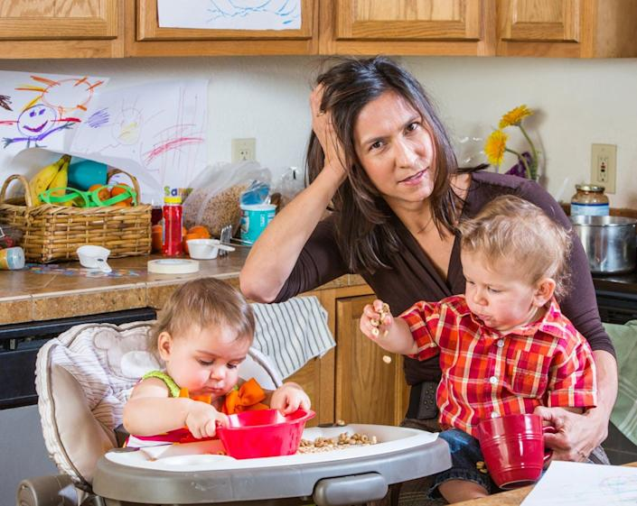 """<span class=""""caption"""">Don't worry about being the perfect mom.</span> <span class=""""attribution""""><a class=""""link rapid-noclick-resp"""" href=""""http://www.shutterstock.com/pic-211539271/stock-photo-stressed-out-mother-in-kitchen-with-her-babies.html?src=RN-RNJce1yr9WHgxEQd4Zg-1-4"""" rel=""""nofollow noopener"""" target=""""_blank"""" data-ylk=""""slk:Mom and kids via www.shutterstock.com."""">Mom and kids via www.shutterstock.com.</a></span>"""