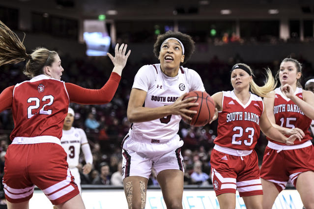 South Carolina forward Victaria Saxton (5) drives to the hoop against South Dakota guard Chloe Lamb (22) during the first half of an NCAA college basketball game Sunday, Dec. 22, 2019, in Columbia, S.C. (AP Photo/Sean Rayford)