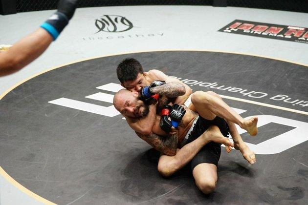 Submission specialist Shinya Aoki moments before he submits Boku in the second round. (Photo: ONE FC)