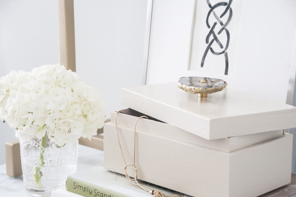 """<p>Believe it or not, making this gorgeous box cost less than $20! Blogger Erin nabbed <a href=""""http://www.michaels.com/artminds-wooden-box/10357776.html"""">this wooden box from Michael's</a>, removed the hardware, glossed it up with a high-shine spray paint, and topped it with an <a href=""""http://www.anthropologie.com/anthro/product/home-hardware/30190979.jsp?color=004&cm_mmc=LS-_-Affiliates-_-QFGLnEolOWg-_-1&utm_medium=QFGLnEolOWg&utm_source=AFFILIATES&utm_content=QFGLnEolOWg&siteID=QFGLnEolOWg-BX8iO6kVXhEw1_j_bQ5RRg#/"""">agate knob from Anthropologie</a> (bought on sale for $14, currently $24). Check out her<a href=""""http://www.earnesthomeco.com/lacquered-agate-box/"""">whole DIY project</a>. <i>(Photo: <a href=""""http://www.earnesthomeco.com/lacquered-agate-box/"""">Earnest Home Co.</a>)</i></p>"""