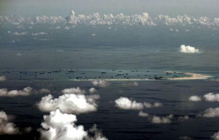 FILE PHOTO:  An aerial photo taken though a glass window of a Philippine military plane shows the alleged on-going land reclamation by China on Mischief Reef in the Spratly Islands