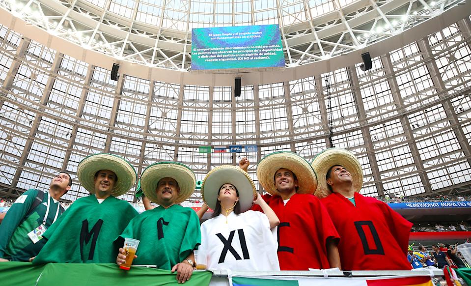 <p>Mexico fans also made a five-person show of support before their opening fixture against Germany. (Getty) </p>