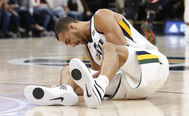 "That right leg is going to keep <a class=""link rapid-noclick-resp"" href=""/nba/teams/uth/"" data-ylk=""slk:Utah Jazz"">Utah Jazz</a> center <a class=""link rapid-noclick-resp"" href=""/nba/players/5197/"" data-ylk=""slk:Rudy Gobert"">Rudy Gobert</a> sidelined for a significant period of time. (AP Photo/Rick Bowmer)"