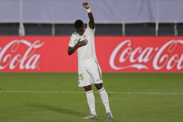 Real Madrid's Vinicius Junior celebrates after scoring the opening goal during the Spanish La Liga soccer match between Real Madrid and Mallorca at Alfredo di Stefano stadium in Madrid, Spain, Wednesday, June 24, 2020. (AP Photo/Bernat Armangue)