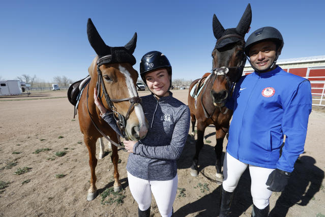 USA Olympic modern pentathlon team members Amro ElGeziry and his wife, Isabella Isaksen pose after practice in Fountain, Colo., Friday, April 24, 2020. Together, Amro Elgeziry and Isabella Isaksen are just your ordinary married Olympic modern pentathlon couple trying to navigate their way through the challenges of training during the coronavirus pandemic. Their sport consists of five events, two of which they can no longer practice -- equestrian horse jumping (stable recently closed) and swimming (pools shut). For the rest, they improvise. (AP Photo/David Zalubowski)