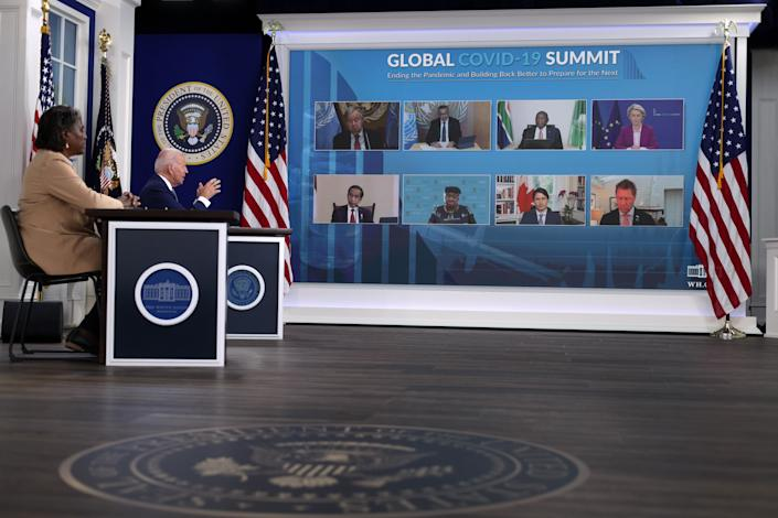 At the White House, President Biden and the U.S. ambassador to the U.N., Linda Thomas-Greenfield, left, take part in a virtual U.N. General Assembly COVID summit Wednesday.