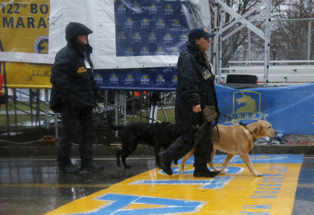 ATF K-9 units cross the start line during a security patrol before the start of the 122nd running of the Boston Marathon in Hopkinton, Mass., Monday, April 16, 2018. (AP Photo/Mary Schwalm)