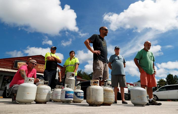 <p>Customers line up to buy propane at Socastee Hardware store, ahead of the arrival of Hurricane Florence in Myrtle Beach, S.C., Sept. 10, 2018. (Photo: Randall Hill/Reuters) </p>