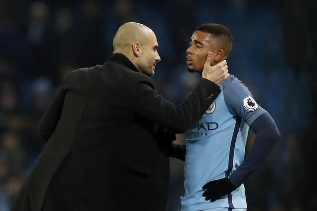 Pep Guardiola speaks to Gabriel Jesus at the end of his Manchester City debut against Tottenham in January 2017 (Martin Rickett/PA)