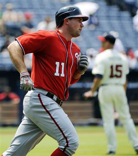 Washington Nationals' Ryan Zimmerman (11) rounds first base on his home run off Atlanta Braves starting pitcher Tim Hudson (15) in the fifth inning of their baseball game, Sunday, July 1, 2012, at Turner Field in Atlanta. (AP Photo/David Tulis)
