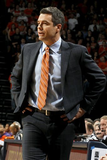 Virginia head coach Tony Bennett reacts to a play during the first half of an NCAA college basketball game against Clemson, Tuesday, Jan. 31, 2012, in Charlottesville, Va. (AP Photo/Andrew Shurtleff)
