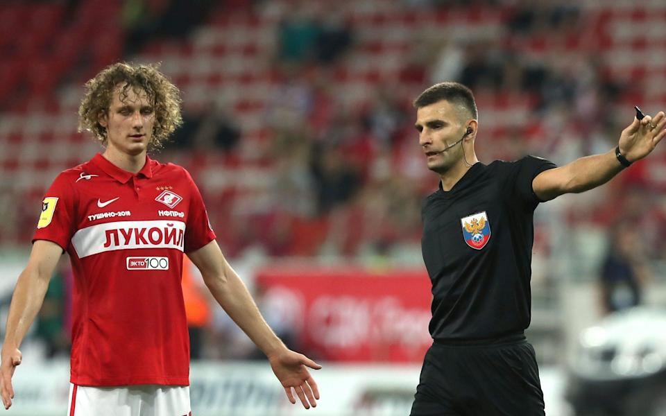 Spartak Moscows Alex Kral (L) and referee Alexei Sukhoi in a 2021/2022 Russian Premier League Round 3 football match between Spartak Moscow and FC Nizhny Novgorod at Otkritie Arena - Anton Novoderezhkin\\TASS via Getty Images