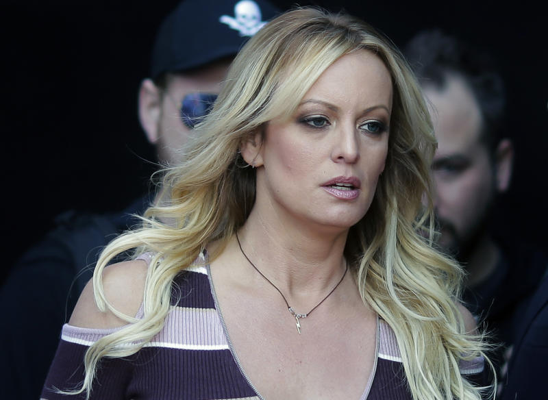 "FILE - In this Oct. 11, 2018, file photo, adult film actress Stormy Daniels arrives at the adult entertainment fair ""Venus"" in Berlin. Daniels has agreed to dismiss a lawsuit that accused her former lawyer of colluding with President Donald Trump's ex-lawyer, Michael Cohen, to have her deny having an affair with Trump. A notice of agreement with Cohen and Daniels' ex-attorney, Keith Davidson, were filed Thursday, May 16, with a Los Angeles court. (AP Photo/Markus Schreiber, File)"