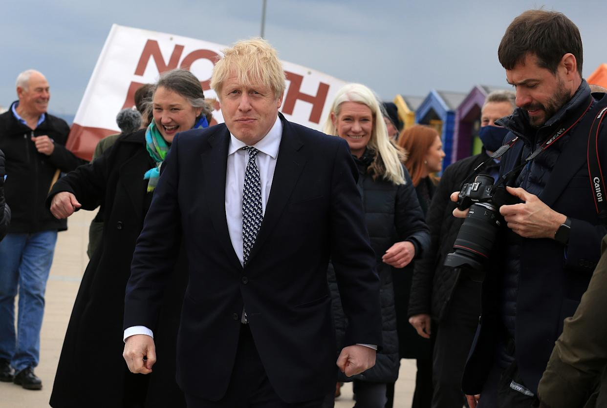 Prime Minister Boris Johnson (centre) reacts as he campaigns on behalf of Conservative Party candidate Jill Mortimer (second left) in Hartlepool, in the north-east of England ahead of the 2021 Hartlepool by-election to be held on May 6. Picture date: Monday May 3, 2021.