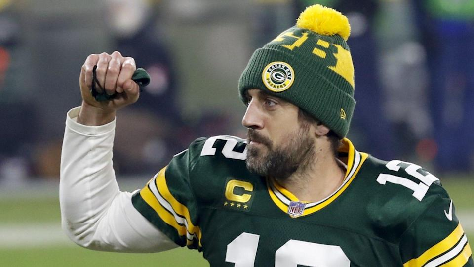 Mandatory Credit: Photo by Mike Roemer/AP/Shutterstock (11713044de)Green Bay Packers quarterback Aaron Rodgers pumps his first after an NFL divisional playoff football game against the Los Angeles Rams, in Green Bay, Wis.