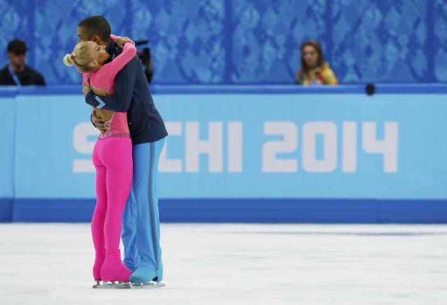 Germany's Aliona Savchenko and Robin Szolkowy celebrate at the end of their program during the Figure Skating Pairs Short Program at the Sochi 2014 Winter Olympics, February 11, 2014. REUTERS/Alexander Demianchuk (RUSSIA - Tags: OLYMPICS SPORT FIGURE SKATING)