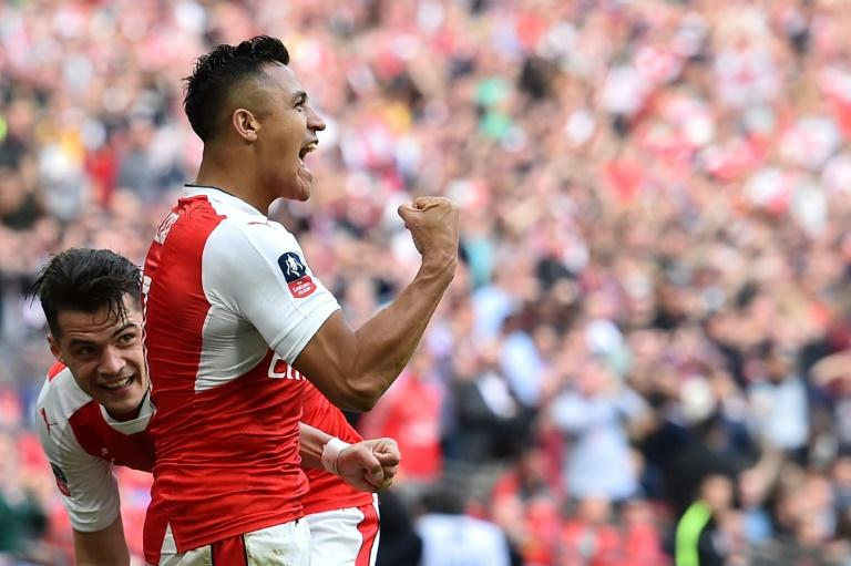 Arsenal's striker Alexis Sanchez (R) celebrates scoring against Manchester City at Wembley stadium in London on April 23, 2017