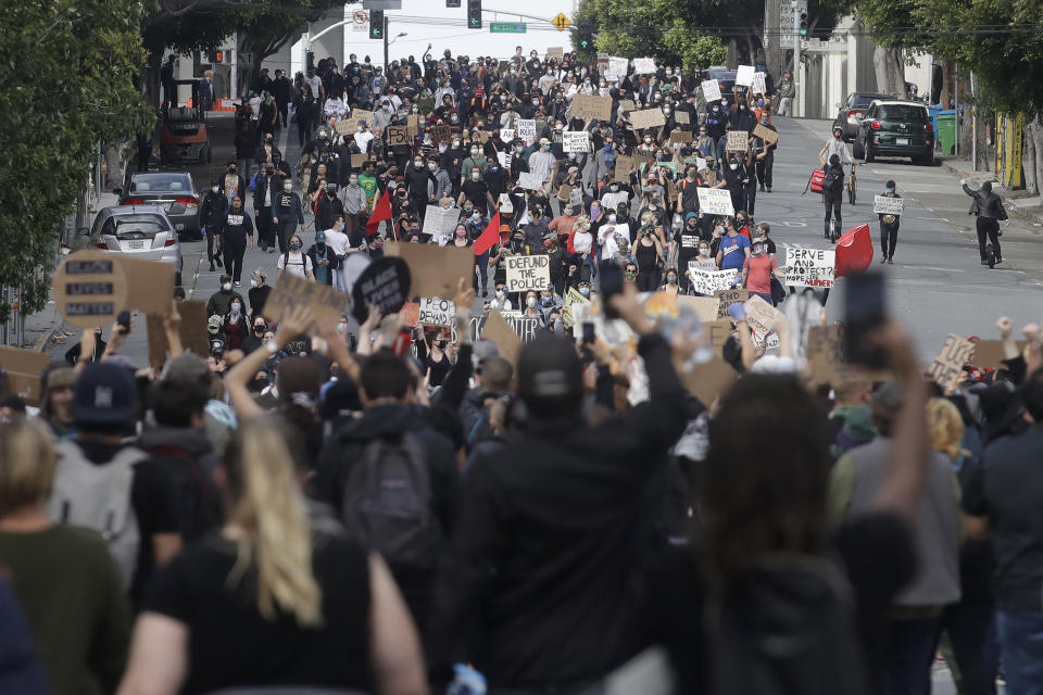 Groups of marchers meet up in San Francisco, Sunday, May 31, 2020, at protests over the Memorial Day death of George Floyd. Floyd was a black man who was killed in police custody in Minneapolis on May 25. (AP Photo/Jeff Chiu)