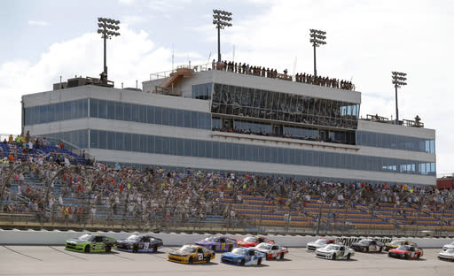 Austin Cindric (22) leads during an early lap in a NASCAR Xfinity Series auto race, Sunday, June 17, 2018, at Iowa Speedway in Newton, Iowa. (AP Photo/Charlie Neibergall)