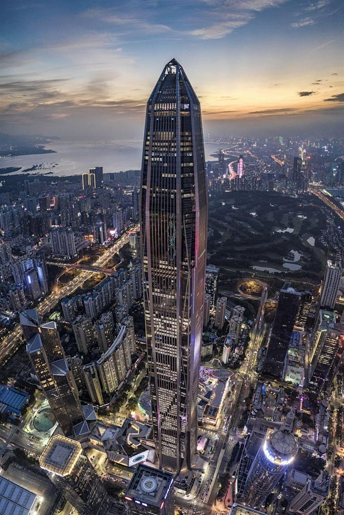 <p><strong>Location:</strong> Shenzhen, China</p><p><strong>Height:</strong> 1,965 feet</p><p><strong>Completion date:</strong> 2017 </p><p>The Special Economic Zone of Shenzhen, China, has really spurred on growth. And that includes upward growth, seen in the 2017 completion of the concrete and steel Ping An Finance Center. Intensely dense and connected into the center of the city—it sits on the high-speed rail corridor—the mix of hotel, office and retail, the 115 floors designed by American firm Kohn Pedersen Fox Associates offers a modern approach to skyscrapers in China.</p>
