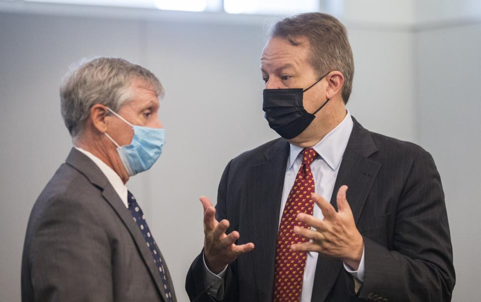 Juul attorney Andrew McGann, right, and Andy Penry, left, an attorney for the state, converse before a hearing regarding the state's case against the e-cigarette company at the Durham County Courthouse in downtown Durham, N.C. on Monday, June 28, 2021. Juul Labs Inc. will pay $40 million to North Carolina and take more action to prevent underage use and sales, according to a landmark legal settlement announced Monday, June 18, 2021, after years of accusations that the company had fueled an explosion in teen vaping. (Julia Wall/The News & Observer via AP)