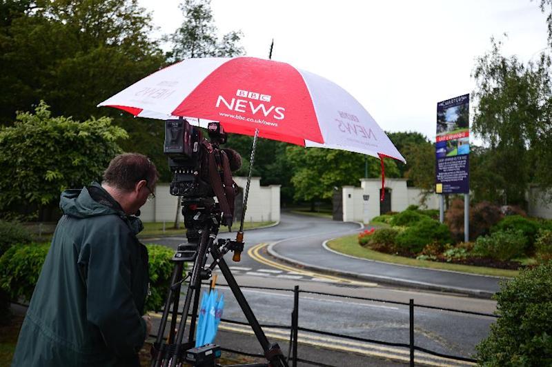 A BBC cameraman films outside a gate leading into a private estate in Sunningdale, west of London, in which pop singer Cliff Richard owns an apartment that was search by police on August 14, 2014