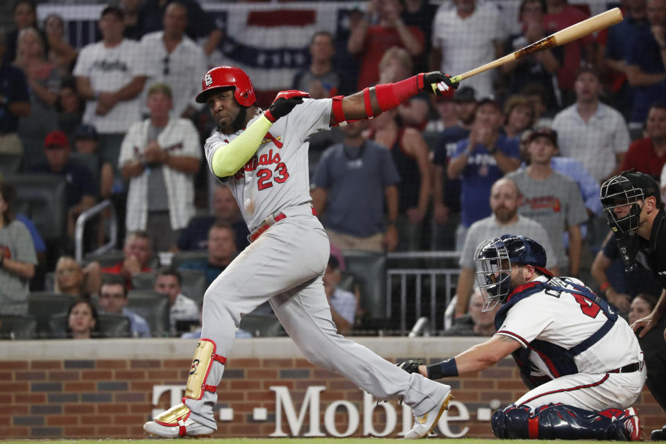 St. Louis Cardinals left fielder Marcell Ozuna (23) hits a two RBI double against the Atlanta Braves in the ninth inning during Game 1 of a best-of-five National League Division Series, Thursday, Oct. 3, 2019, in Atlanta. (AP Photo/John Bazemore)