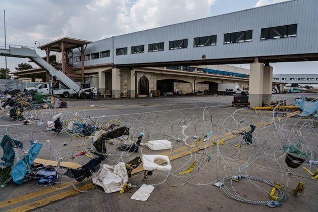 Scenes around the abandoned airport area where civilians were processed for evacuations. (Photo: Marcus Yam)