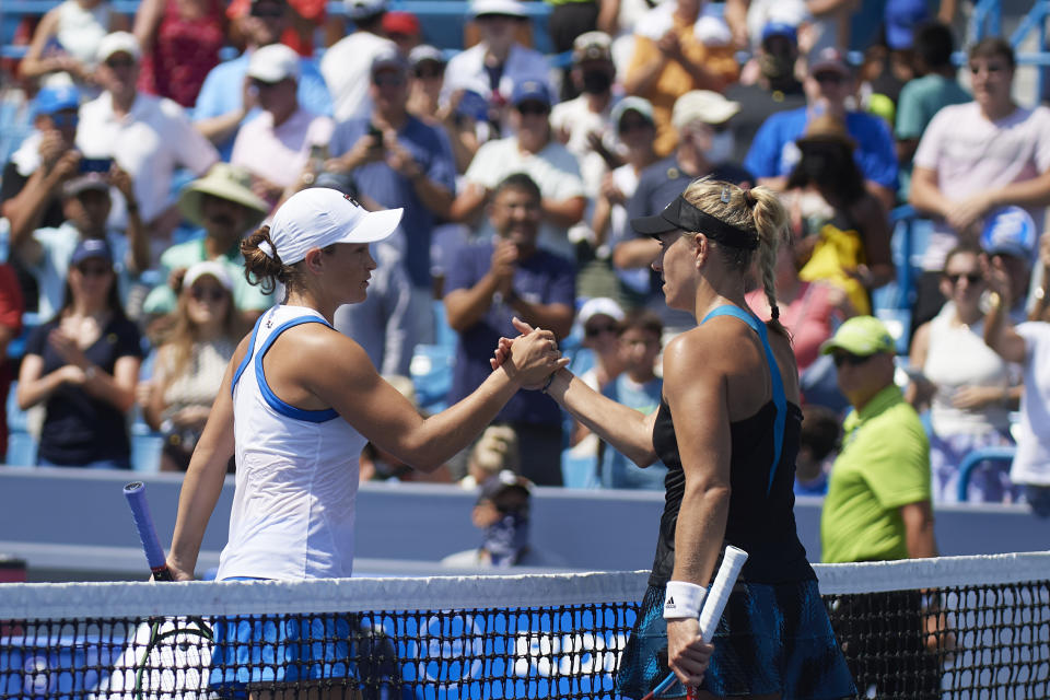 Angelique Kerber (pictured right) shakes hands with Ash Barty (pictured left) at the Southern & Western Open.