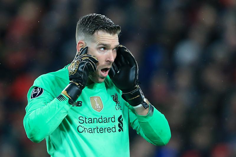 Liverpool goalkeeper Adrian points to his head during the UEFA Champions League round of 16 match.