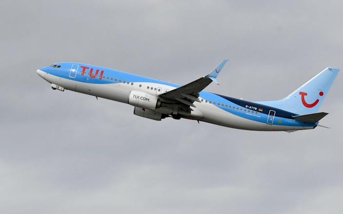 TUI airline takes-off at the airport in Duesseldorf, western Germany - INA FASSBENDER/AFP