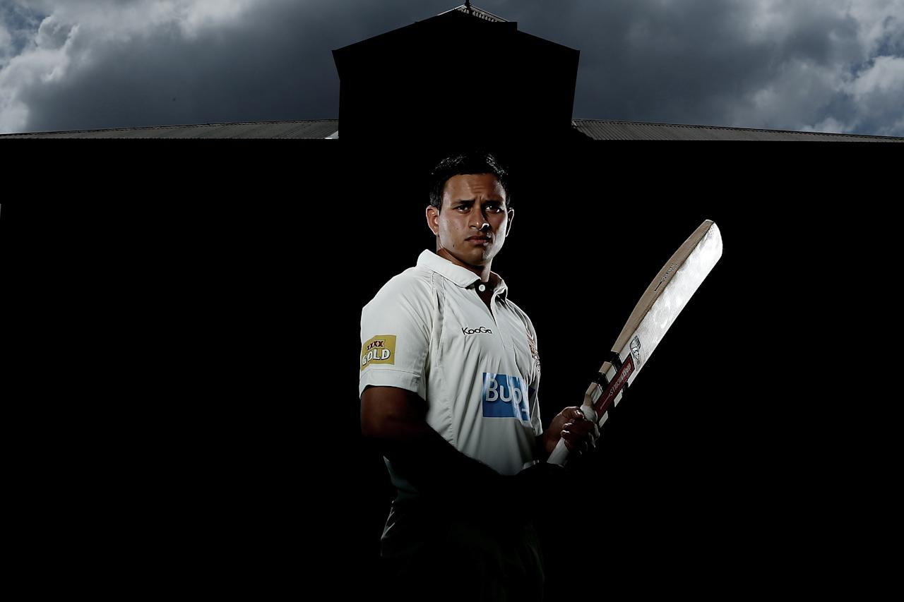 BRISBANE, AUSTRALIA - SEPTEMBER 25:  (EDITORS NOTE: Image has been desaturated.) Usman Khawaja of the Queensland Bulls poses during a portrait shoot at Allan Border Field on September 25, 2012 in Brisbane, Australia.  (Photo by Chris Hyde/Getty Images)
