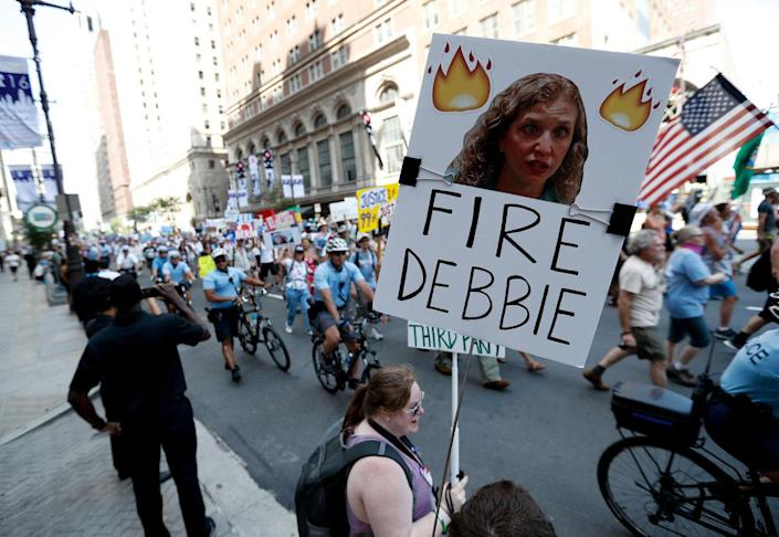 <p>A supporters of Sen. Bernie Sanders, I-Vt., holds up a sign call calling for Debbie Wasserman Schultz, chairwoman of the Democratic National Committee to be fired, Sunday, July 24, 2016, in Philadelphia. The Democratic National Convention starts Monday. (AP Photo/Alex Brandon)</p>