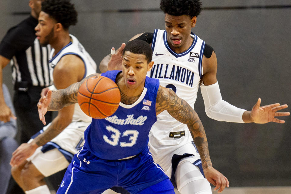 Seton Hall guard Shavar Reynolds (33) is fouled by Villanova forward Brandon Slater (3) during the first half of an NCAA college basketball game, Tuesday, Jan. 19, 2021, in Villanova, Pa. (AP Photo/Laurence Kesterson)