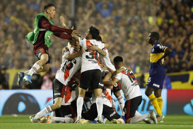 River Plate players celebrate qualifying for the final, at the end of their 0-1 loss to Boca Juniors in a Copa Libertadores semifinal second leg soccer match at La Bombonera stadium in Buenos Aires, Argentina, Tuesday, Oct. 22, 2019. River won 2-1 on aggregate and qualified to the final. (AP Photo/Natacha Pisarenko)