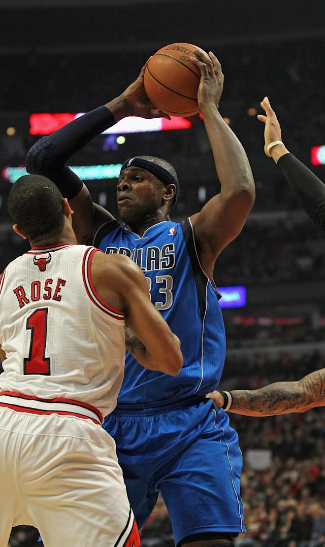 CHICAGO, IL - APRIL 21: Brendan Haywood #33 of the Dallas Mavericks looks to pass under pressure from Derrick Rose #1 of the Chicago Bulls at the United Center on April 21, 2012 in Chicago, Illinois. NOTE TO USER: User expressly acknowledges and agress that, by downloading and/or using this photograph, User is consenting to the terms and conditions of the Getty Images License Agreement. (Photo by Jonathan Daniel/Getty Images)