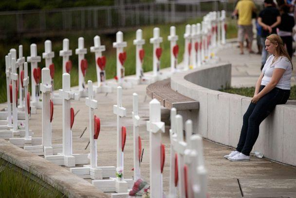 PHOTO: A woman visits a memorial with wooden crosses for each of the 49 victims of the Pulse Nightclub next to the Orlando Regional Medical Center, June 16, 2016 in Orlando, Fla. (Drew Angerer/Getty Images, FILE)