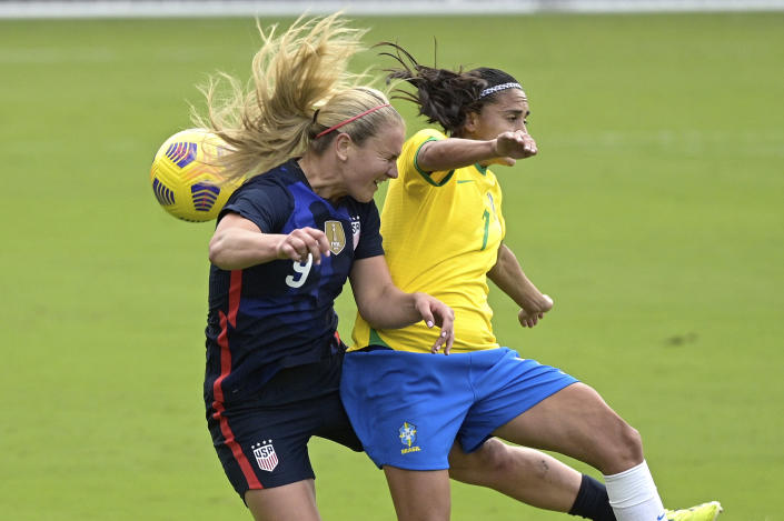 United States midfielder Lindsey Horan (9) and Brazil midfielder Andressa (7) compete for a header during the first half of a SheBelieves Cup women's soccer match, Sunday, Feb. 21, 2021, in Orlando, Fla. (AP Photo/Phelan M. Ebenhack)