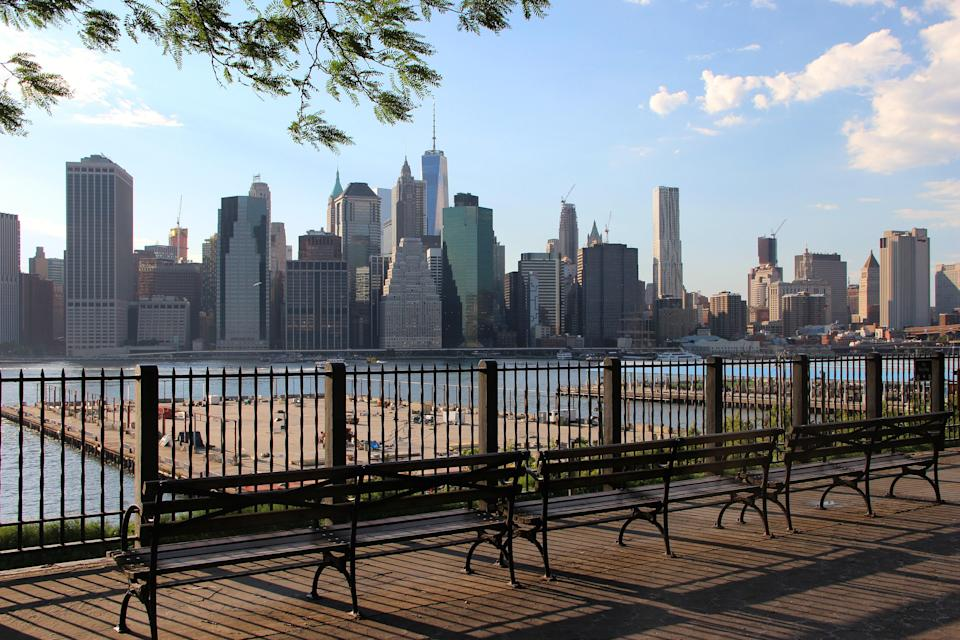 """It's one thing to be in the midst of Manhattan, on the ground; it's quite another to look upon it from across the river. In <a href=""""https://www.cntraveler.com/story/our-favorite-new-yorkers-on-the-best-things-in-all-five-boroughs?mbid=synd_yahoo_rss"""" rel=""""nofollow noopener"""" target=""""_blank"""" data-ylk=""""slk:Brooklyn Heights"""" class=""""link rapid-noclick-resp"""">Brooklyn Heights</a>, a hop, skip, or couple subway stops away from downtown, the city's image looms large before you. Arguably the best view of the skyline in the city, the Brooklyn Heights promenade floats above the Brooklyn-Queen Expressway. Underlying the peaceful, tree-lined walkway, traffic rumbles below. The promenade stretches from Remsen Street at the south end to Middagh Street at the north. Around the corner, pedestrians can discretely cross a basketball court to access a suspended footbridge that zigzags down to the piers. While in the picturesque neighborhood, makes stops at the New York Transit Museum, Sardinian restaurant River Deli, and the old-time dive bar Montero."""