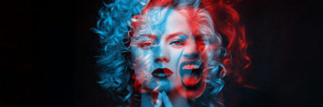 Calm and angry woman. Double color exposure.